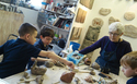 "Children in a ""Shaping Clay, Shaping Life"" workshop"
